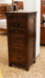 New On Display Mission Jewelry Armoire With seven drawers, lift-top with mirror, and side wings with necklace hooks. Flush mission style with round dark antique copper knobs. Solid Rustic Cherry in Asbury OCS117 19in W x 16 3/4in D x 48in H Solid Hardwood Furniture Made in the USA The Amish Home Furniture in Pittsburgh Mills
