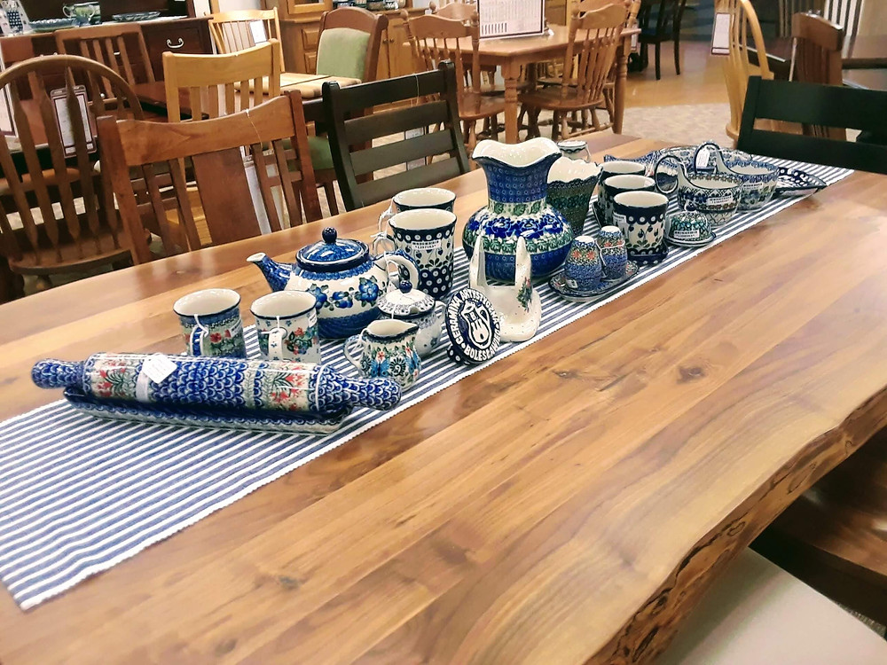 Polish pottery vase, napkin holder, salt and pepper set, rolling pin with stand, mugs, teapot, cream pitcher, sugar bowl, planter, triple planter set with tray, soup mugs, butter bell