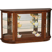 Large Console Curio with Rounded Sides | 2 adjustable shelves with plate groove, mirror back, clear glass, LED touch light, brass pull with lock | Brown Maple in Acres OCS106 | 49in W x 13in D x 30in H | The Amish Home | Amish Furniture at the Pittsburgh Mills