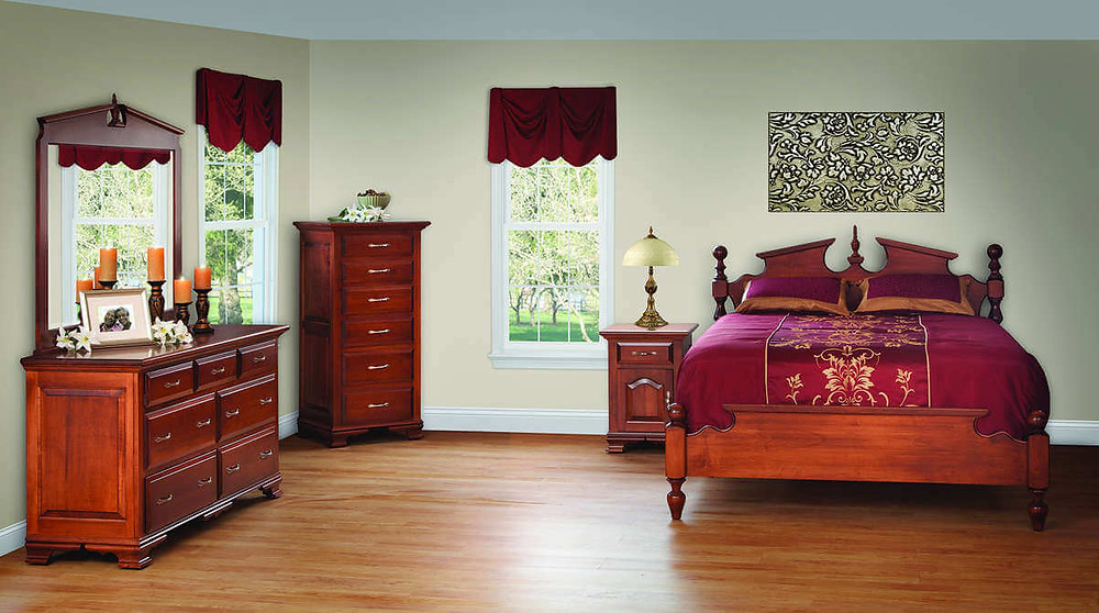 The Regal Bedroom is shown in cherry and includes aqueen  poster bed, double dresser, pediment mirror, lingerie chest, and 1 drawer 1 door nightstand
