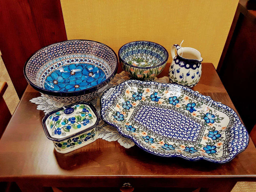 "- Small Box with Lid - Limeberry - Nesting Bowl 9"" - Blue Cosmo - Unikat (U4) Pattern - Pedestal Bowl - Lucky Ladybug - Unikat (U3) Pattern - Cream Pitcher 11oz - Bleeding Hearts - Oval Scalloped Platter - Cobblestone Garden - Ceramika Artystyczna Bolesławiec Polish Pottery - The Amish Home - Galleria at Pittsburgh Mills Amish Furniture"