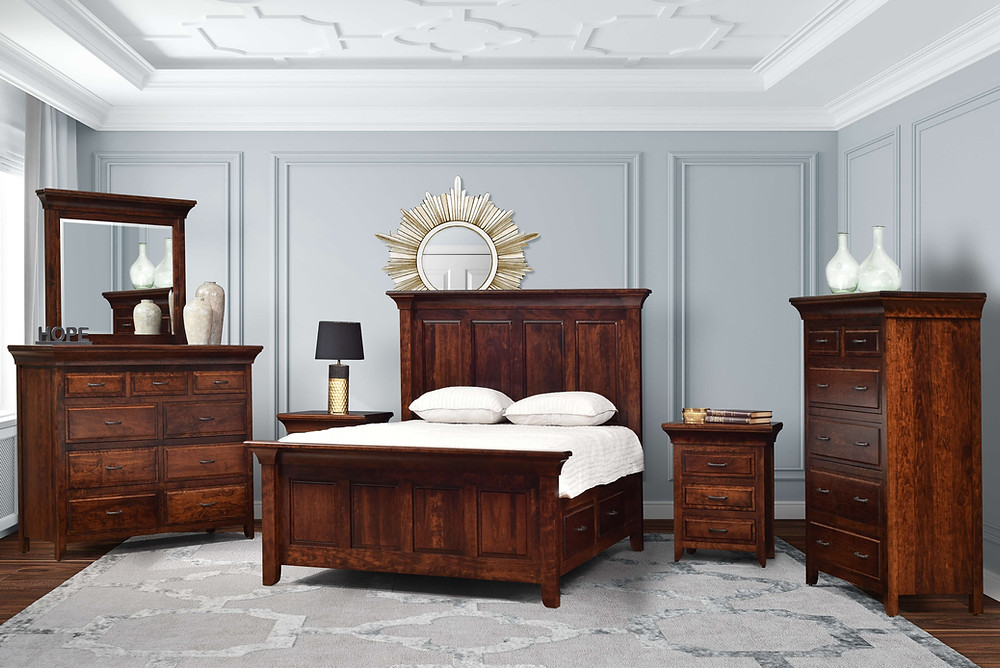 The Marcella Bedroom furniture collection is shown in solid rustic cherry with asbury stain. queen panel bed with high headboard and storage drawer rails for underbed storage, nightstand with three drawers and sliding top with hidden compartment, dresser with 9 drawers plus two hidden drawers and mirror, bureau with six drawers plus hidden jewelry drawer with velvet lining on a push-to-open mechanism. Solid hardwood furniture made in the usa amish furniture pittsburgh mills