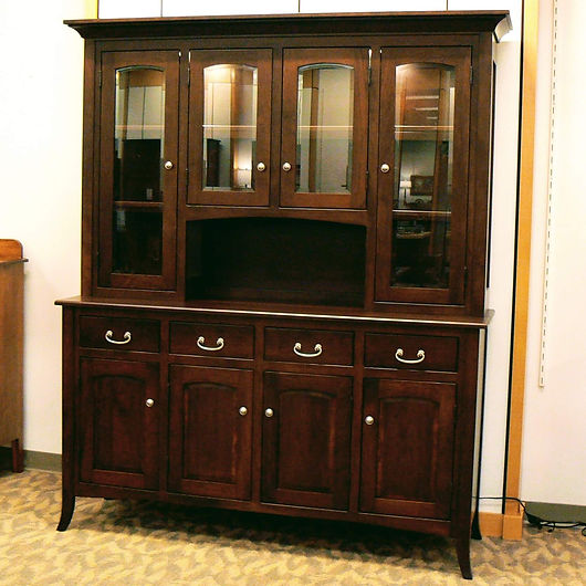 New On Display English Shaker 4-Door Hutch 4-Door china cabinet has arched raised-panel doors and curved feet. Top has long doors on the side and an open counter in the center. Solid Cherry in Coffee OCS226 69in W x 20in D x 81in H Solid Hardwood Furniture Made in the USA The Amish Home Furniture in Pittsburgh Mills