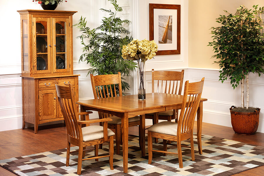 English Shaker Dining Room Furniture collection, featuring 2 door china cabinet, with dining table and 4 chairs, shown in oak with brushed nickel hardware