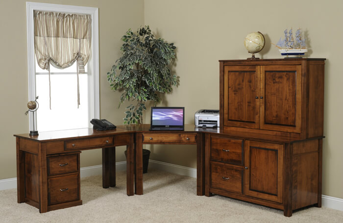 "The Arlington Modular Office Collection is shown in brown maple  and includes a 48"" table desk, corner desk, 48"" credenza, 48"" hutch, and rolling file cabinet"