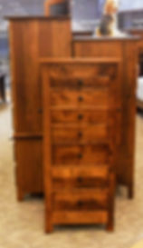 New On Display Mission Jewelry Armoire With seven drawers, lift-top with mirror, and side wings with necklace hooks. Flush mission style with round black knobs. Solid Brown Maple in Michaels OCS113 19in W x 16 3/4in D x 48in H Solid Hardwood Furniture Made in the USA The Amish Home Furniture in Pittsburgh Mills