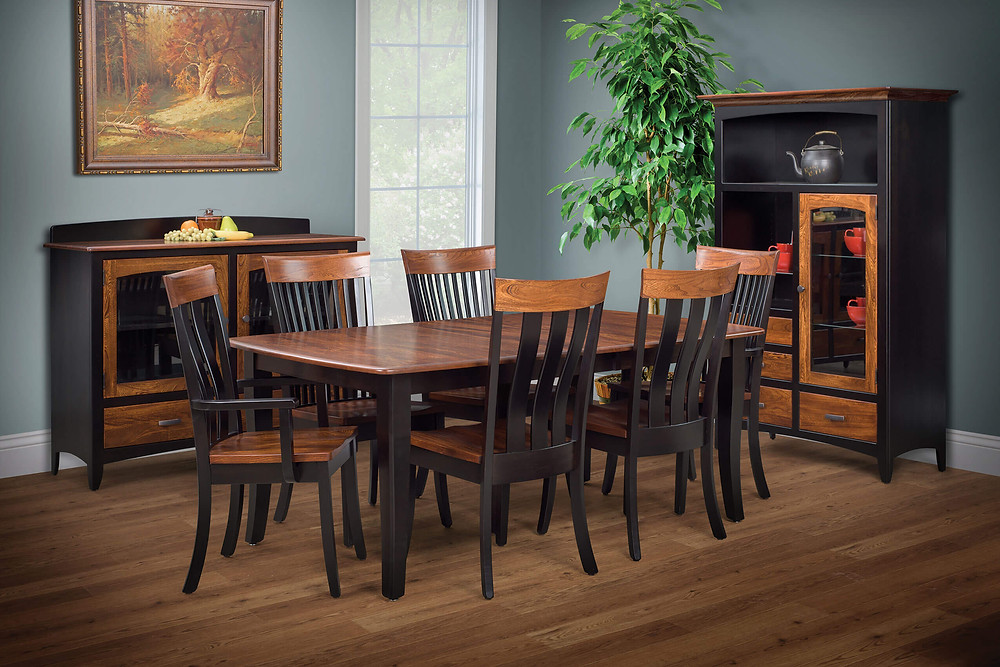The Belmont Dining Room Furniture Collection is shown with two-tone finish in brown maple with onyx black stain and elm with michaels red stain. Table has boat shaped top in elm with flared shaker legs and apron in brown maple with onyx stain, chairs are brown maple with elm seats and top rail, server has two doors with curved glass and two drawers with elm fronts, elm top and a brown maple backsplash gallery, dining cabinet has one door with arched glass panel and four drawers with elm fronts, and three open shelves with elm top. Solid hardwood furniture made in the usa amish furniture pittsburgh mills