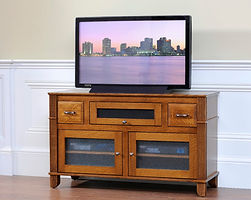 Arlington TV Stand with 2 Glass Doors, 2 Drawers, and 1 Flip-Up Door with Speaker Cloth | Quartersawn White Oak in Michaels OCS113 | 50in W x 18in D x 29 1/2in H | The Amish Home | Amish Furniture at the Pittsburgh Mills