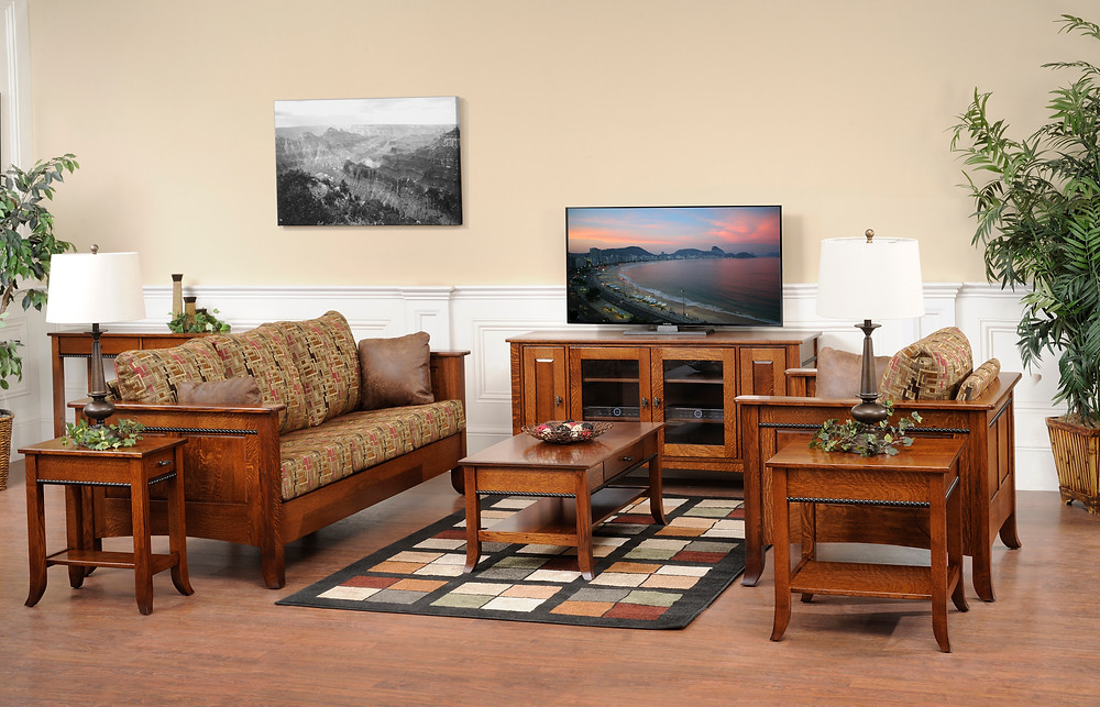 The Butler TV Stand is shown in quartersawn white oakwith matching coffee table end table and hall table