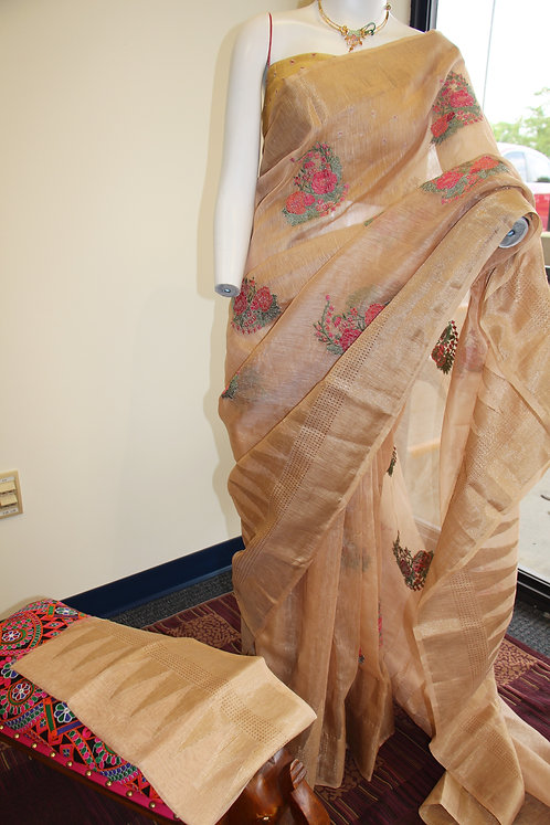Beige color linen saree with fine resham embroidery