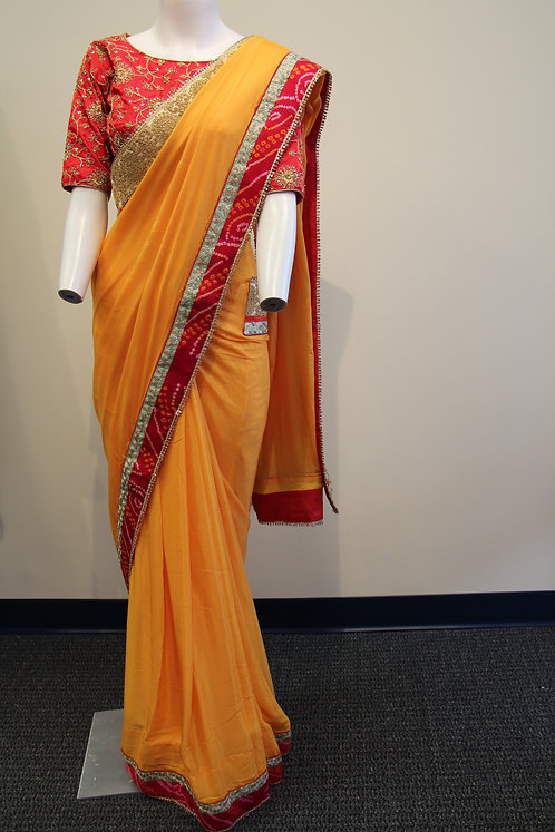 Yellow Georgette Fancy Saree with Red Bandhani Lace