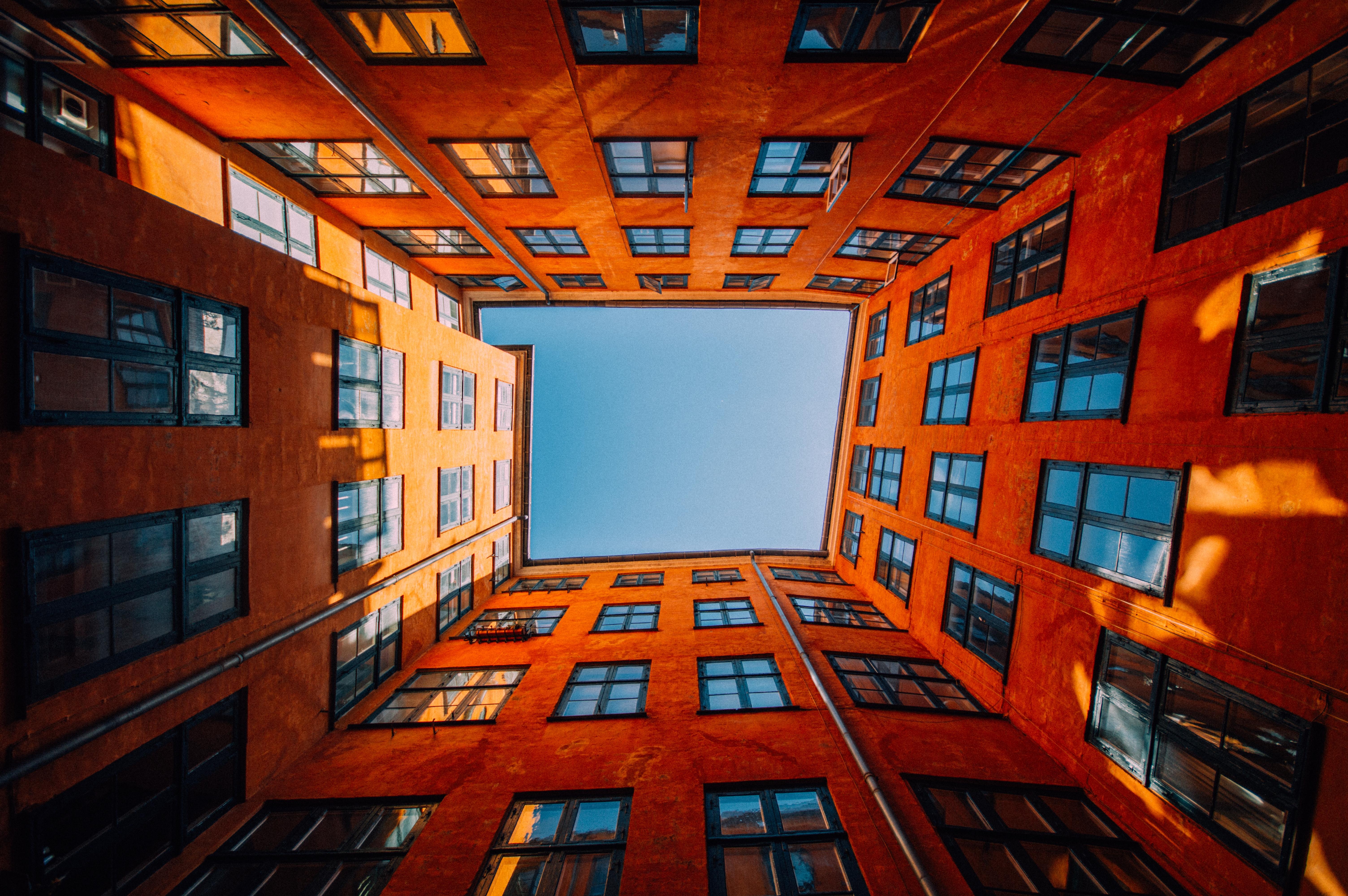 low-angle-shot-unique-high-rise-orange-b