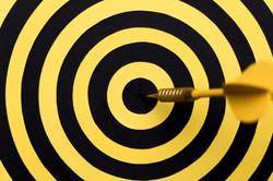close-up-dartboard-center-with-arrow
