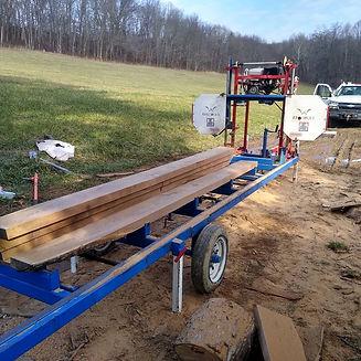 cut lumber on saw.jpg