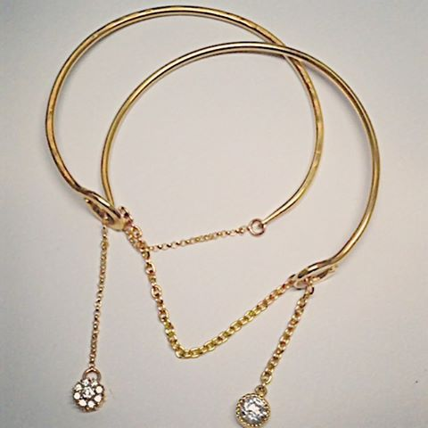 Gold and diamond chained bangles