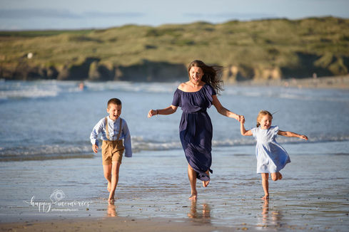 Family relaxed photo by the seaside