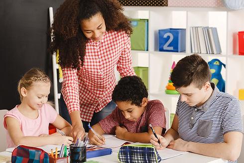 class-working-with-teacher-PHZFV4H.jpg