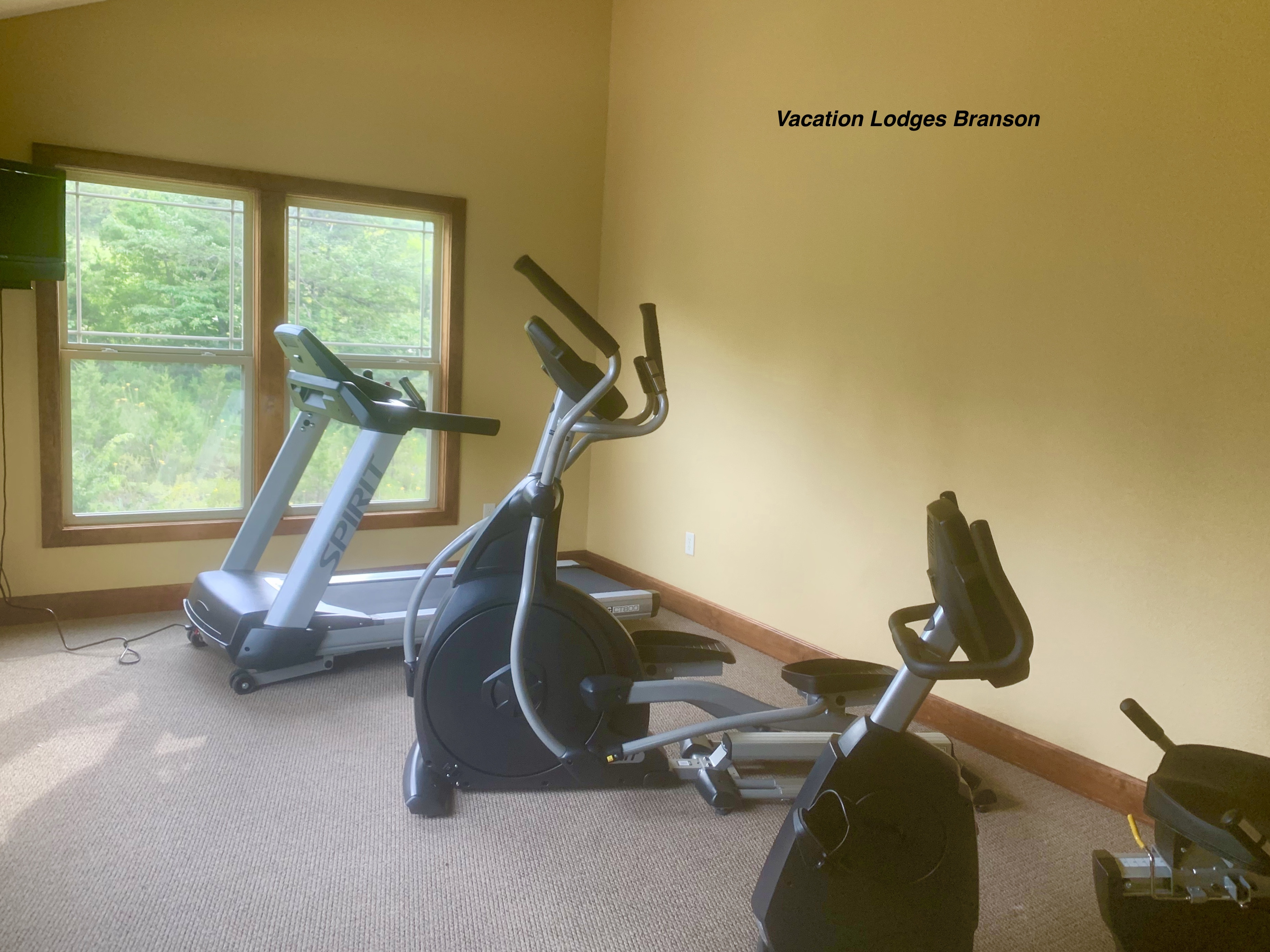 Fitness Room Treadmill, Elliptical, and