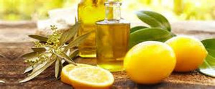 Showing Lemon fruits, herbs and its Essential Oil.