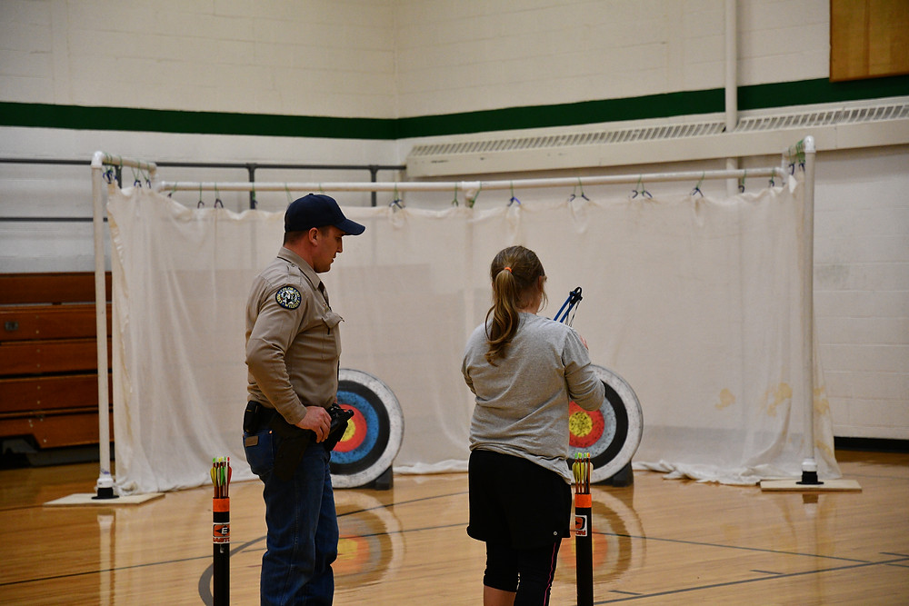 Justin Morris assisting with archery