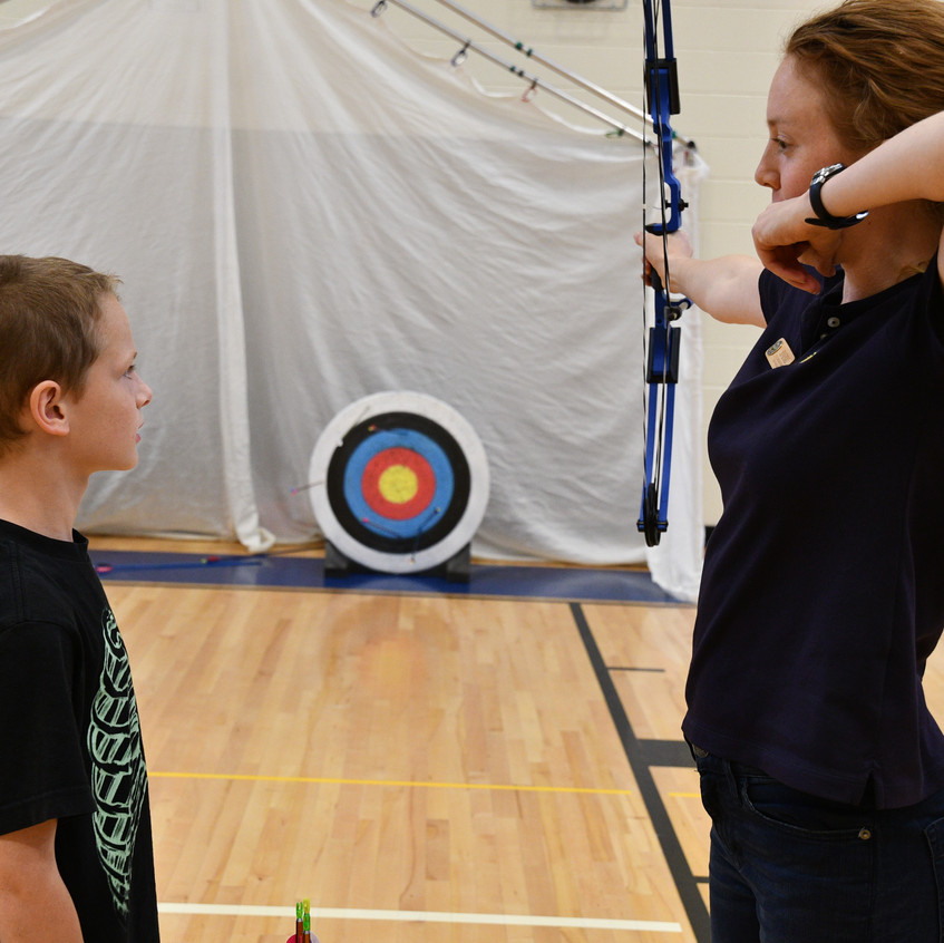 Erin giving some archery tips.