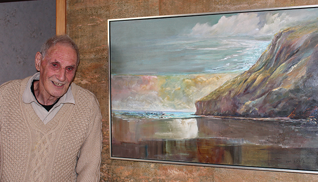 Ian Loretz stands next to one of his favourite artworks