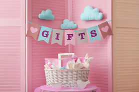 Flags with word _gifts_ and basket with