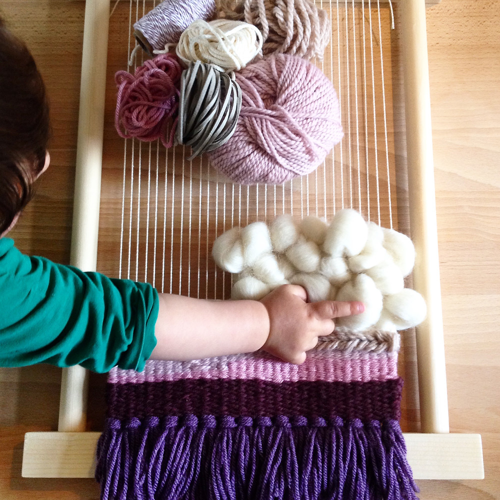 loom weaving and baby hand