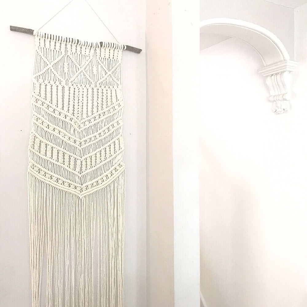 large macrame wall hanging in my hallway