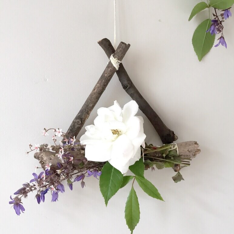 triangle wreath with foraged flowers