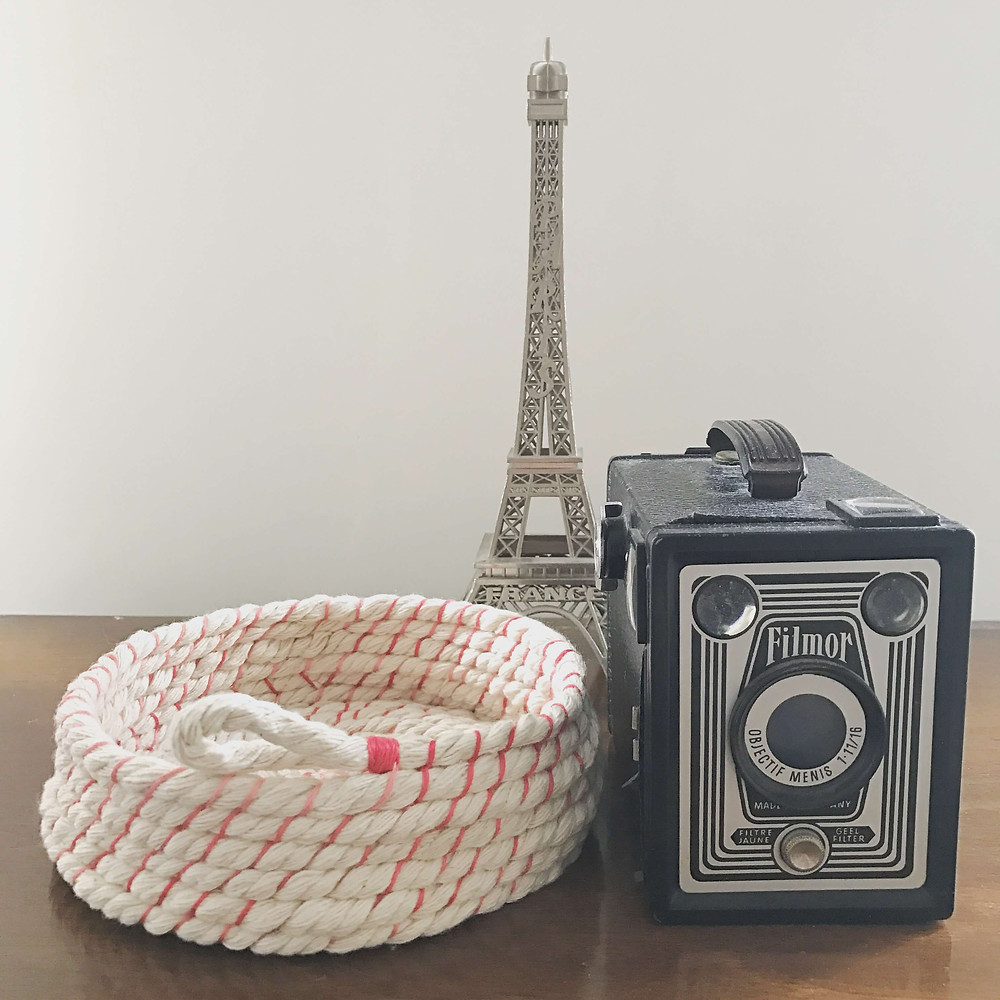 rope bowl, antique camera and the Eiffel Tower