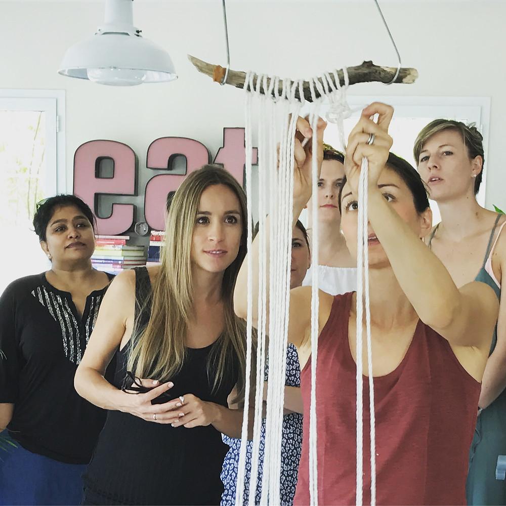 myself teaching a macrame wall hanging class in Dubai