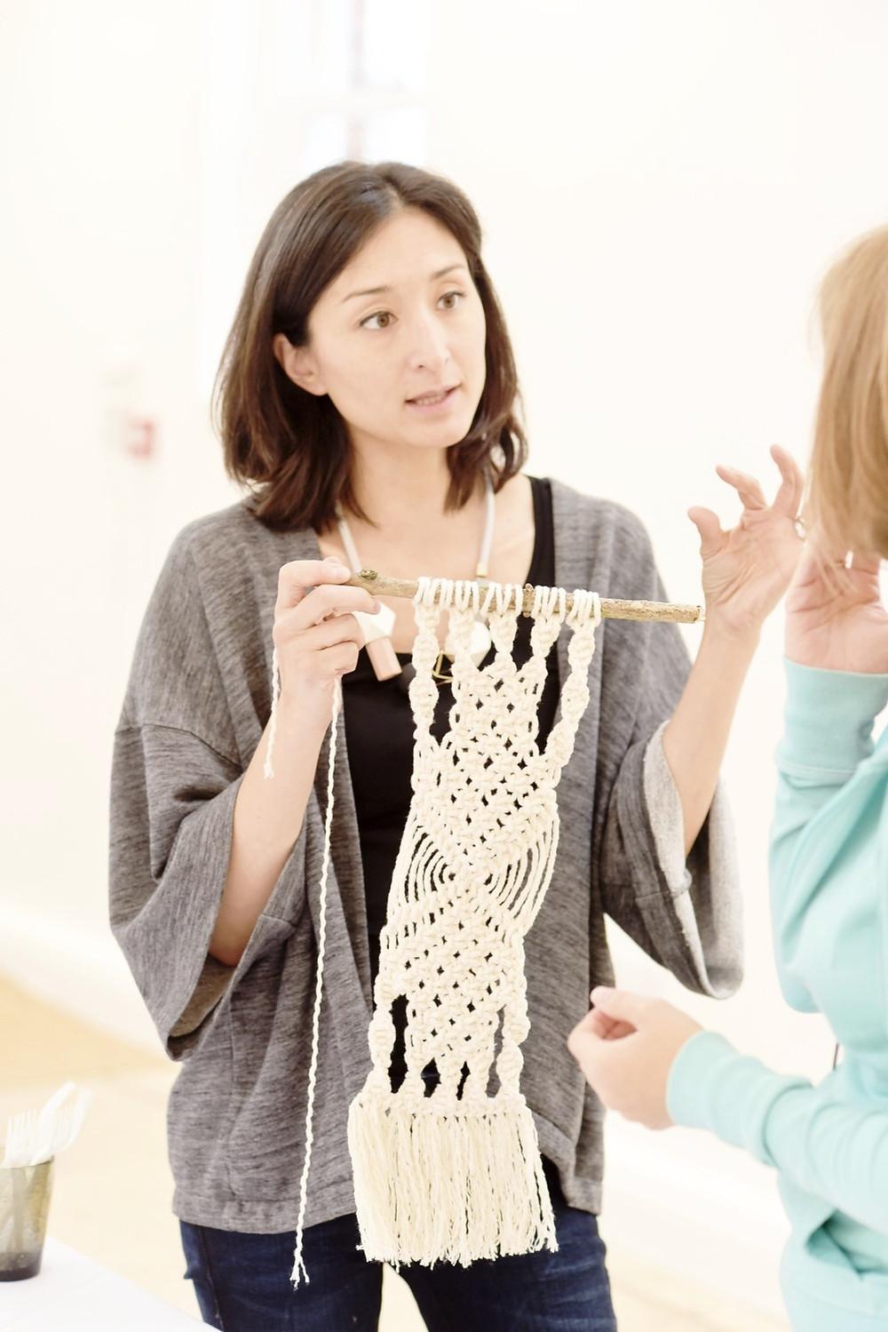 Isabella Strambio teaching macrame