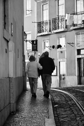 a couple calmly enjoy Alfama