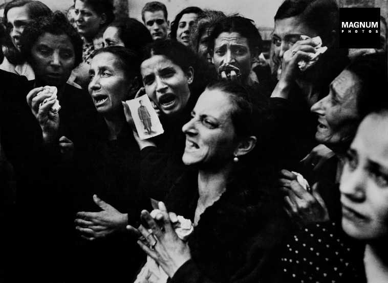 ITALY. Naples. October 2, 1943. Women crying at funeral of twenty teenage partisans who had fought the Germans before the Allies entered the city.