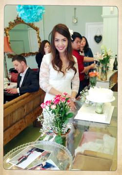 Nhing cutting her cake