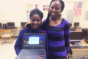 A young student and her caregiver hold their new Tech Goes Home Chromebook
