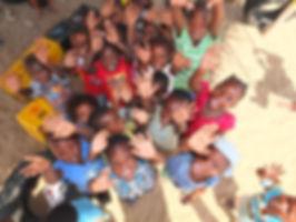 African school kids happy and waving