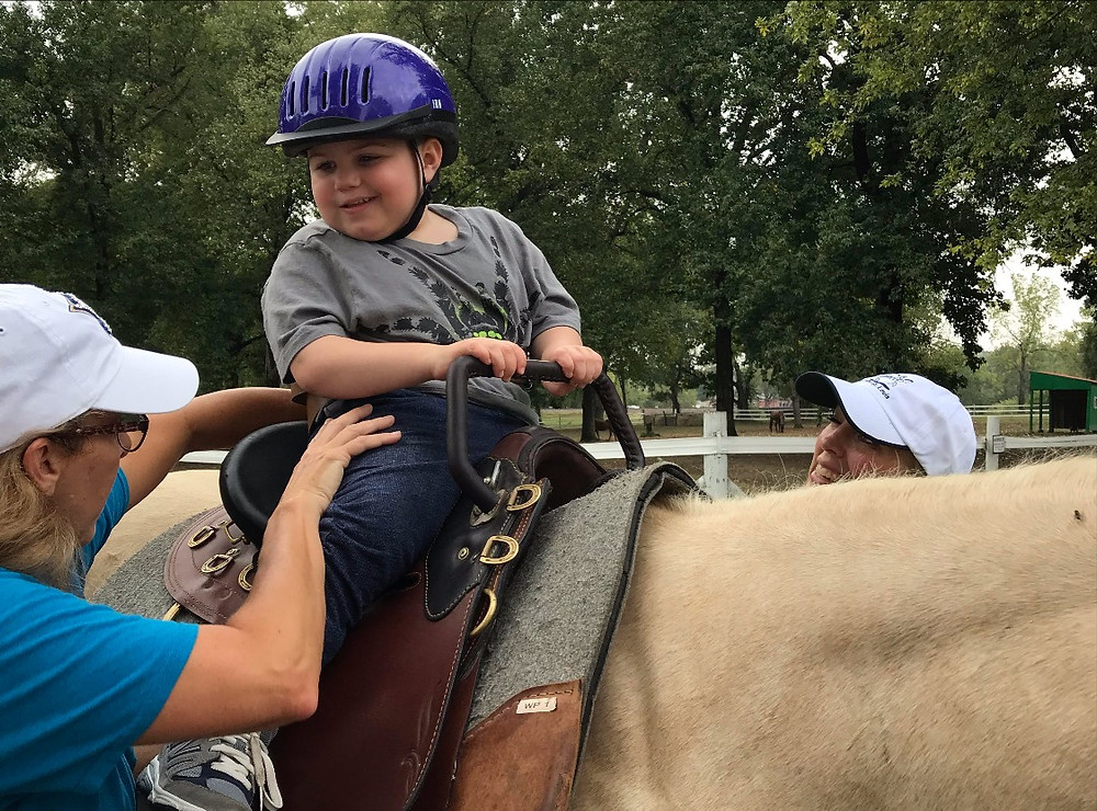 Ride On St. Louis equine-assisted occupational therapy client