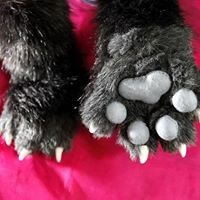 black and grey hand paws with grey fleece pads and yellow fimo claws