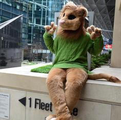 lion fursuit furry tailor Naima Mipsy sitting