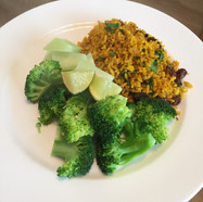 spicy ricey with broccoli and lime wedges
