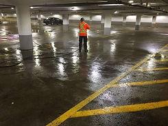 Man Power Washing Underground Parking Garage