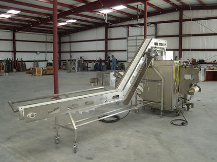 VOLUMETRIC FEED CONVEYOR AND ASSEMBLY CO