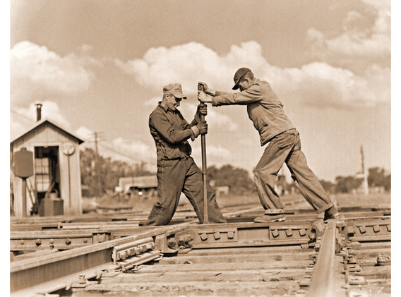 Track Workers Tightening Bolts