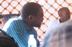 An attendee of the debate at Makerere University