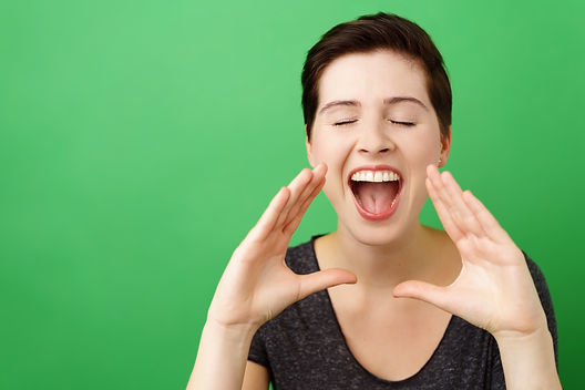 Portrait of young woman screaming with e