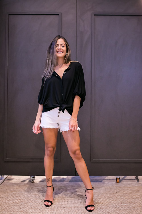 Frente do shorts jeans branco les cloches