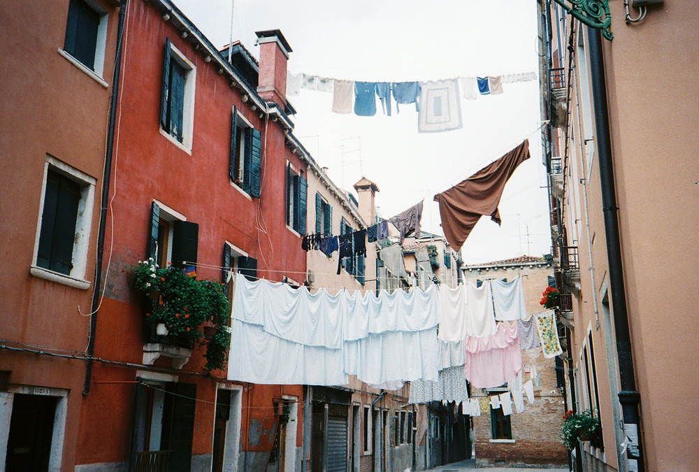 laundry hanging between Venice residential buildings
