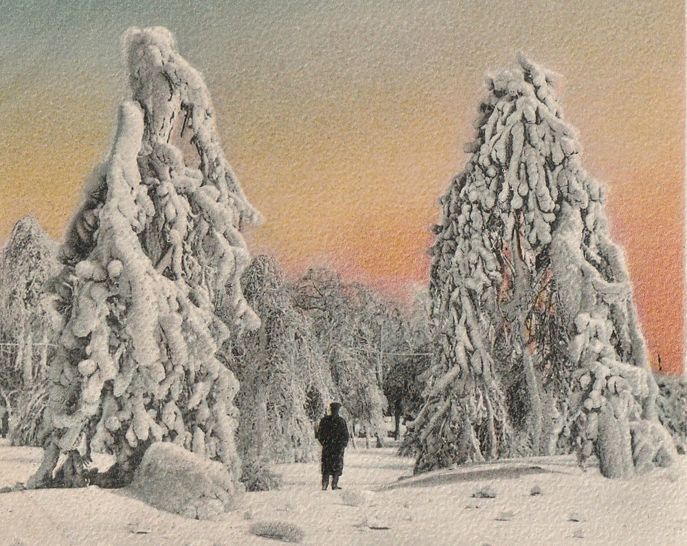 vintage illustrated postcard of shadow figure man surrounded by snow and snowy trees with pastel sunset in the background